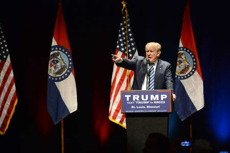 mococa: Saint Louis, MO, USA - March 11, 2016: Donald Trump talks to supporters at the Peabody Opera House in Downtown Saint Louis.
