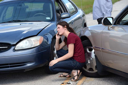 telephone call: Young woman making phone call after accident Stock Photo