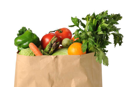 produces: Produce in paper grocery bag isolated over white background Stock Photo