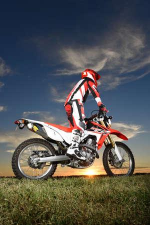 Man riding motocycle at dusk