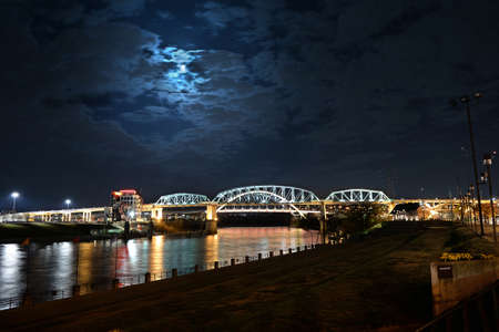 tn: View of the Shelby bridger in Nashville, Tennessee at night with moon light