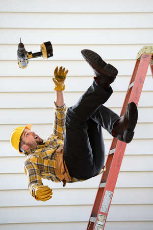 Worker falling from ladder inside room