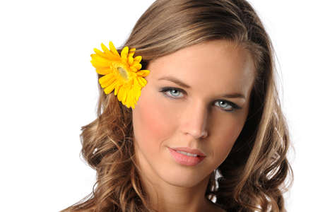 Beautiful young woman with yellow daisy isolated over white background photo