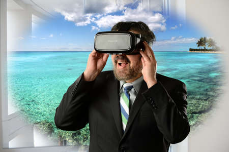 tropica: Businessman using virtual reality glasses to visit tropical island