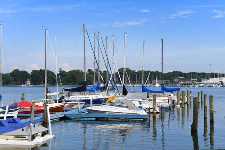 traverse: Harbor in Holland Michigan with sailboats on lake
