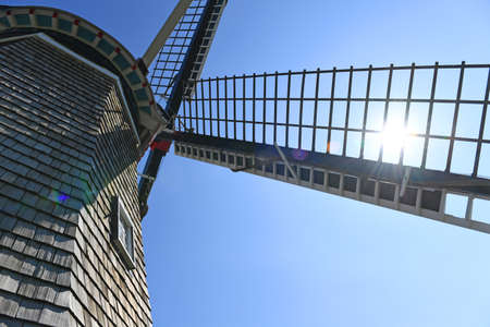 Close up view of windmill in Holland Michigan with sun shinning through blade Stock Photo