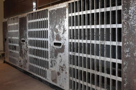 prison: Prison cells with metal bars