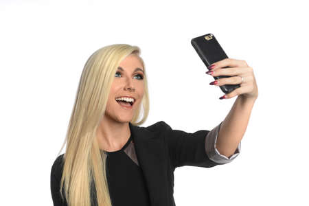 Portrait of beautiful young businesswoman taking selfie isolated over white background Banque d'images