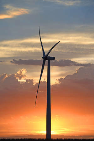 Wind turbine at sunset with colorful sky