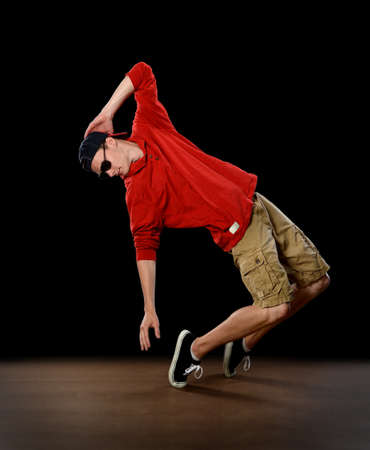 Young hip hop dancer performing on stage Banque d'images