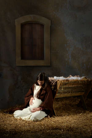 Pregnant Mary and the manger on Christmas Eve