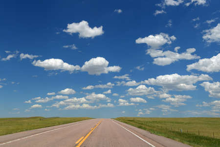 blue sky: Road and landscape with clouds and blue skies