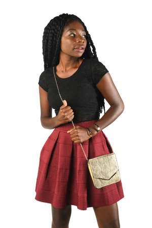Beautiful African American woman holding purse isolated over white background Banque d'images