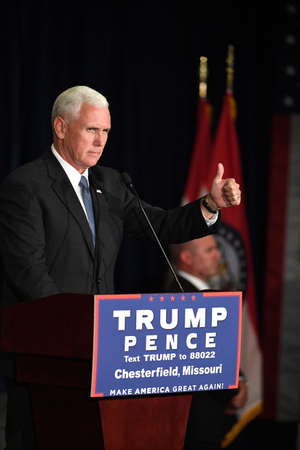governor: Chesterfield, MO, USA – September 06, 2016: Republican vice presidential candidate, Indiana Governor Mike Pence speaks to supporters at a rally in Chesterfield, Missouri.