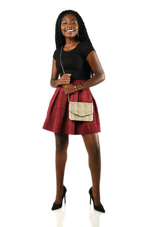 Portrait of African American woman in skirt isolated over white background
