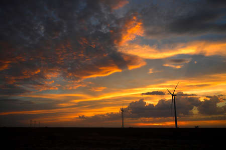 Wind turbines at sunset on a Kansas farm