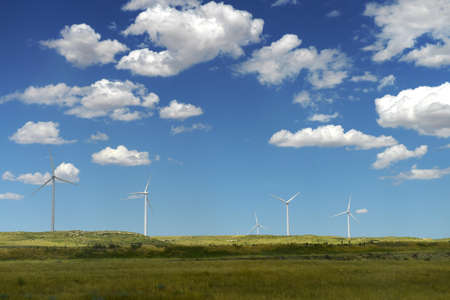 Wind turbines in open field during bright day