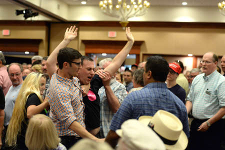 chesterfield: Chesterfield, MO, USA – September 06, 2016: A protester is taken out of event at Pence rally for Trump in Chesterfield, Missouri.