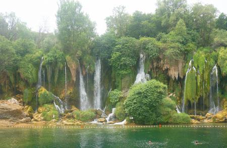 Kravice waterfalls in Bosnia and Herzegovina. Green background. Stock Photo