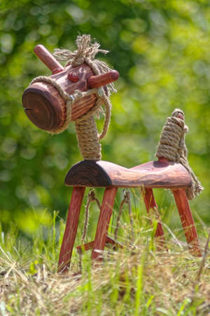 vintage furniture: wooden horse on grass Stock Photo