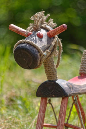 wooden horse on grass Stock Photo