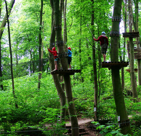rope bridge: The Climbing Park in Schwerin  Photograph of a group of children on a tree platform in an obstacle course                       Stock Photo