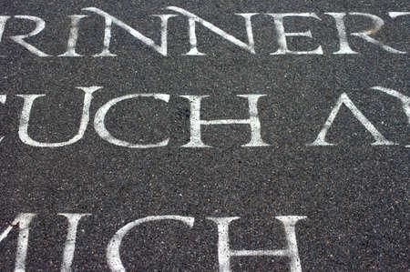 bird 's eye view: A sidewalk with sprayed on word phrases                     Stock Photo