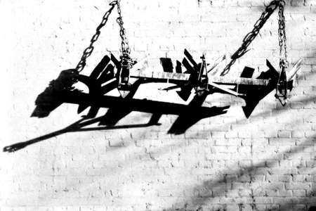 plough: plough which hangs on a barn
