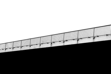 The monochrome photograph of a bridge railing                   photo