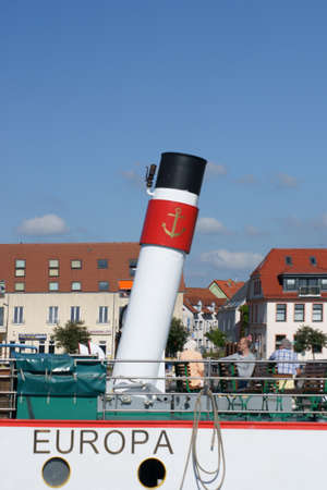 close up chimney: Waren, Mecklenburg Western Pomerania  Germany - June 09, 2013: The entrance of the passenger ship Europe in the port of the sea  M�ritz on June 09, 2013 in Waren