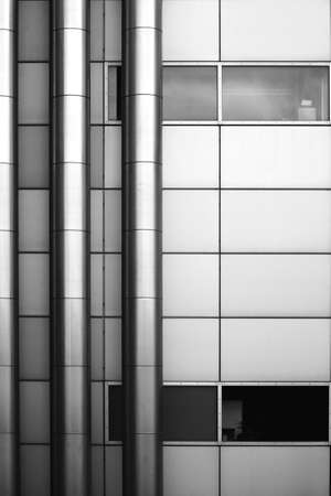The abstract photograph of stainless steel tubes on a metal facade