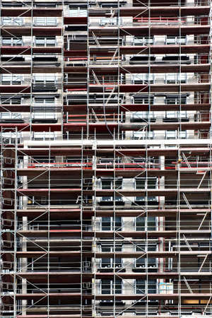 multi storey: The photograph of a tower covered up with scaffolding         Stock Photo