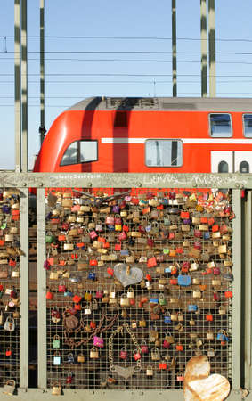 The Photography of love locks on the fence of the Hohenzollern Bridge in Cologne