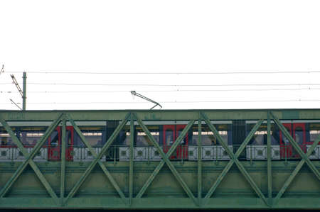 crossbars: The photograph of the Vienna tram via frog perspective, which goes over a steel bridge