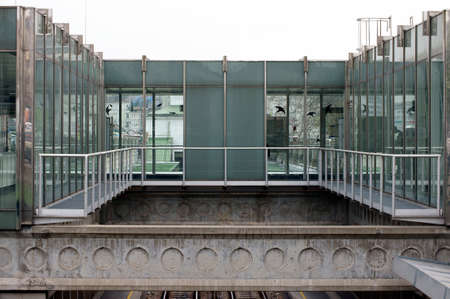 struts: The photograph of a glass passage at a tram stop