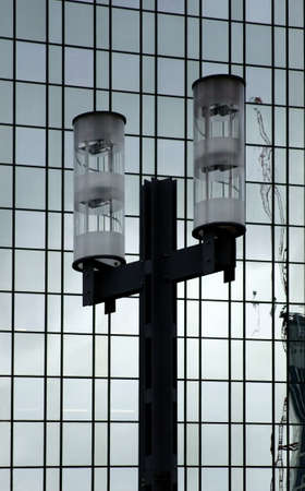 gratings: The photograph of a lantern in front of a modern facade