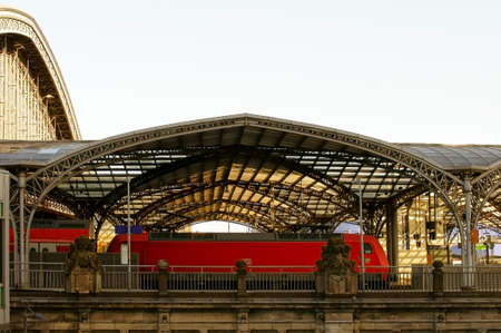 struts: Cologne, Germany - February 02, 2014  A red train of the German Federal Railways stands in the historic underpass of the Cologne railway station on February 02, 2014 in Cologne