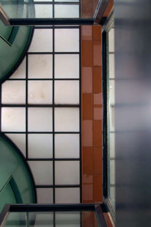 The photograph of a ceiling with ceiling paneling, partitions and tiles