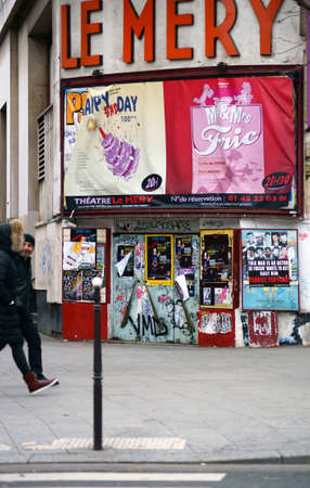 Paris, France - January 1, 2014  Pedestrians pass the theater Le Mery in the Montmartre area on January 01, 2014 in Paris