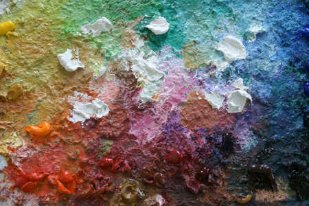 The photograph of a palette with oil paint                     photo