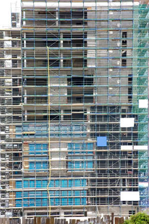 The photograph of a building covered up  with scaffolding                        photo