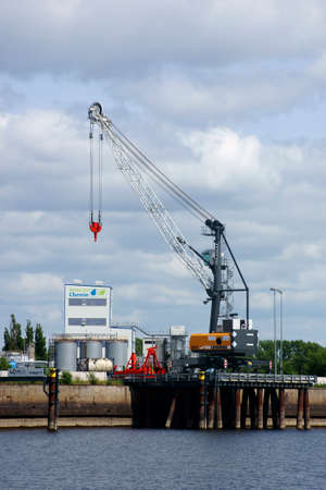 chemical  industry: Wittenberge, Germany - June 18, 2014  The new port  ElbePort  with a dock and a crane of the chemical industry  Prignitzer chemistry  on June 18, 2014 in Wittenberge                     Editorial