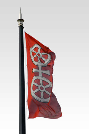 The photograph of a waving flag in the wind with the Mainz city arms