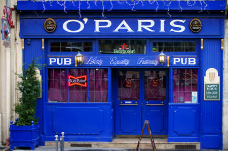 beer bar: Paris, France - December 30, 2013  The colorful and illuminated entrance of the beer bar O  Paris on December 30, 2013 in Paris