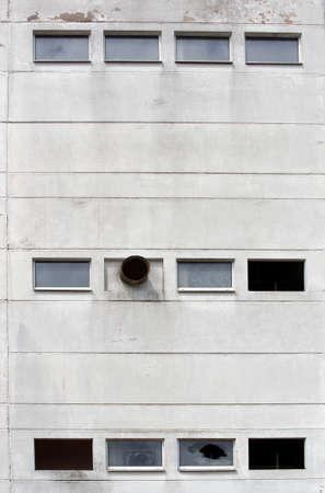 splintered: The Photography of broken windows and a crumbling facade of an industrial ruin                        Stock Photo