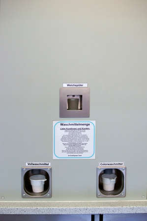 automat: The photograph of a detergent automat in a laundromat.