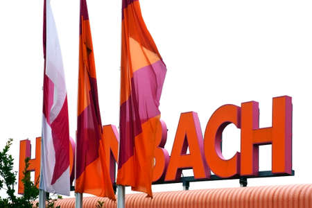 Mainz, Germany - September 4, 2014: The bright orange signboard of the Hornbach DIY store with waving flags on September 04, 2014 in Mainz.