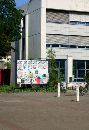food distribution: Mainz, Germany - August 9, 2014: The entrance to the cafeteria with a bike rack and a billboard on the site of the Johannes Gutenberg University on August 09, 2014 in Mainz.