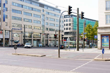 trams: Magdeburg, Germany - September 28, 2014: The intersection at the Otto-von-Guericke in Magdeburg road with trams, shops and people on September 28, 2014 in Magdeburg.