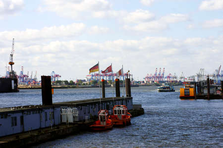 conveyors: The industrial port of Hamburg with cranes, conveyors, ships and boats.